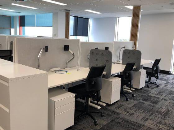 Workplace Fitout, Essential Height adjustable desks Leo Mesh task Chairs custom power blades