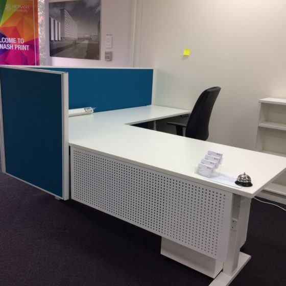 Modesty panel perforated dots reception desk