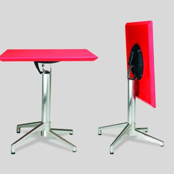 Zinnia table with red top and chrome base, one set up and one flipped