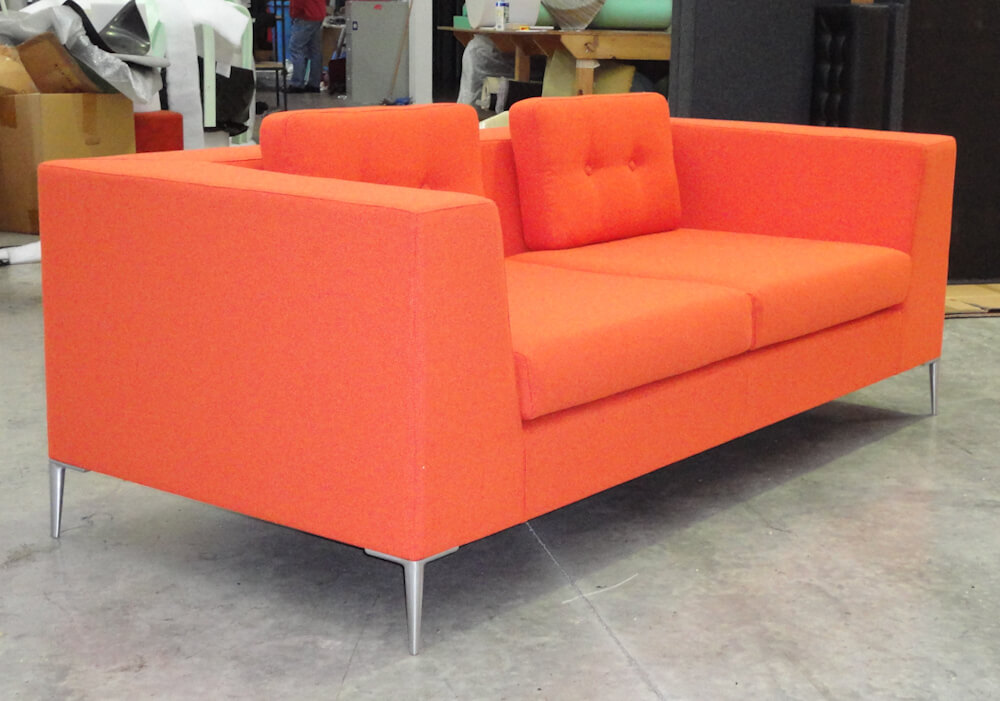 Orange cloud 3 seater sofa with separate rear cushions with button detail