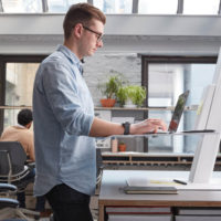 Humanscale Quickstand Eco Height Adjustable desktop unit with laptop