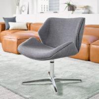 Skara lounge chair, low back, fully upholstered with polished aluminium swivel base