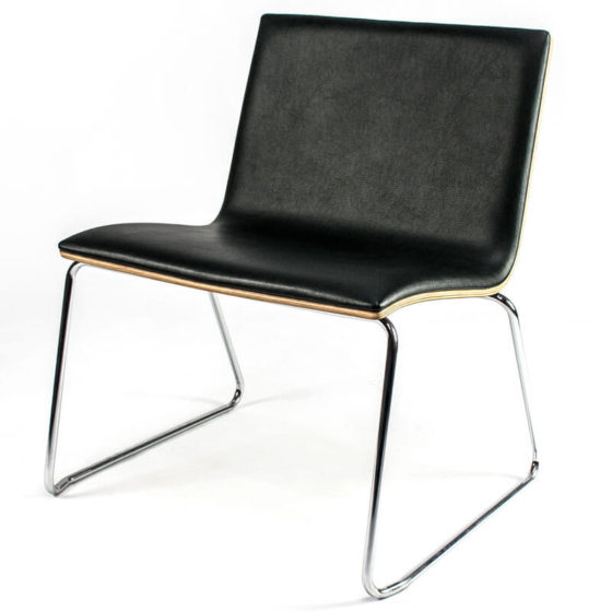 Zig lounge chair with black leather topper to ply seat. Chrome Sled base.