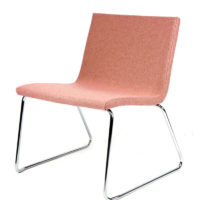 Zig lounge chair with upholstered shell on sled base.