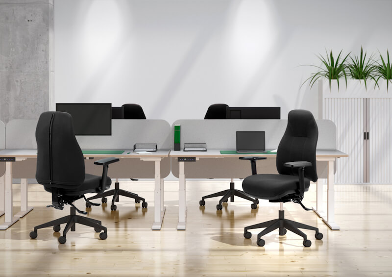 Image of four Orthopod Classic 135 by Therapod task chairs within office at height adjustable desks