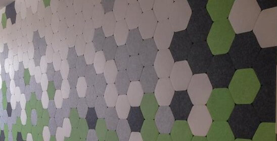 Acoustic wall tile stickers on wall in hexagon like shape