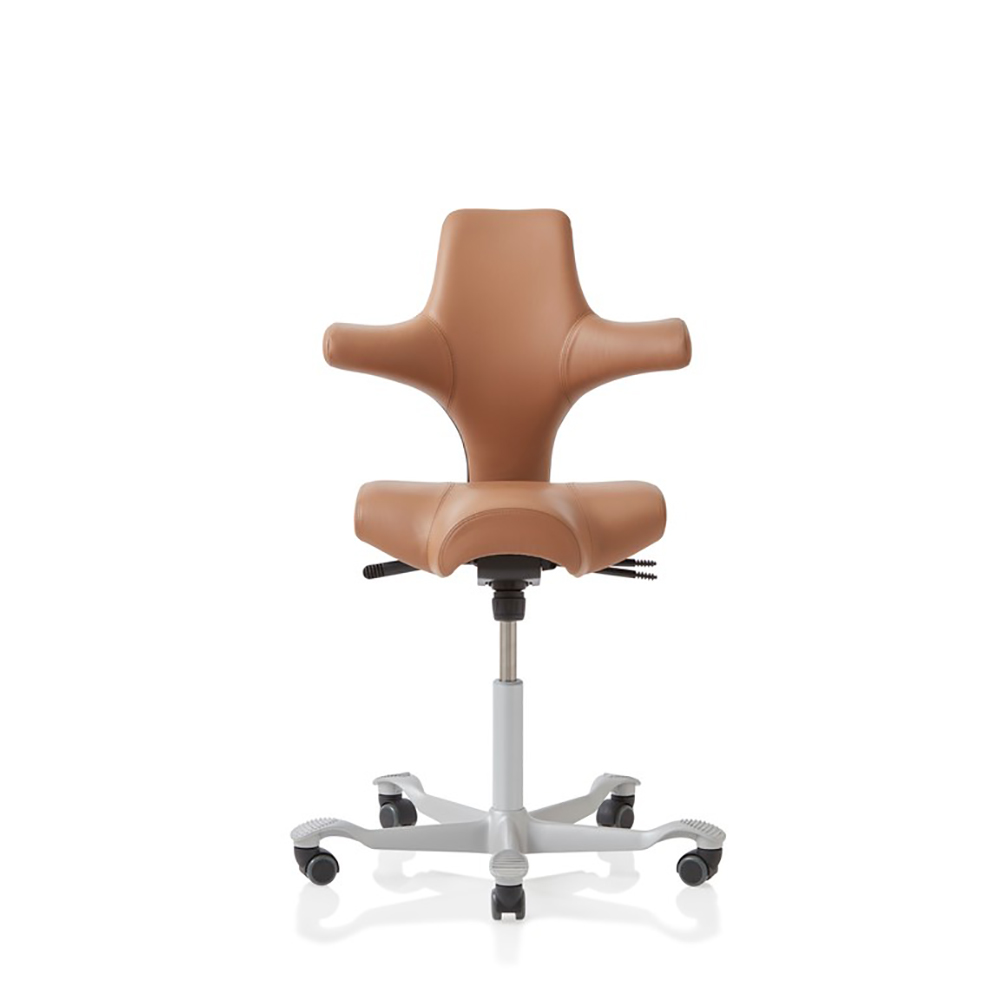 Capisco 8106 Saddle chair in tan with silver five star base